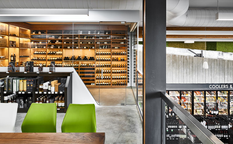 The mezzanine area of this modern liquor store has been designedfor the purpose of private tasting events, industry workshops, and neighborhood cultural gatherings. #RetailDesign #LiquorStore #InteriorDesign