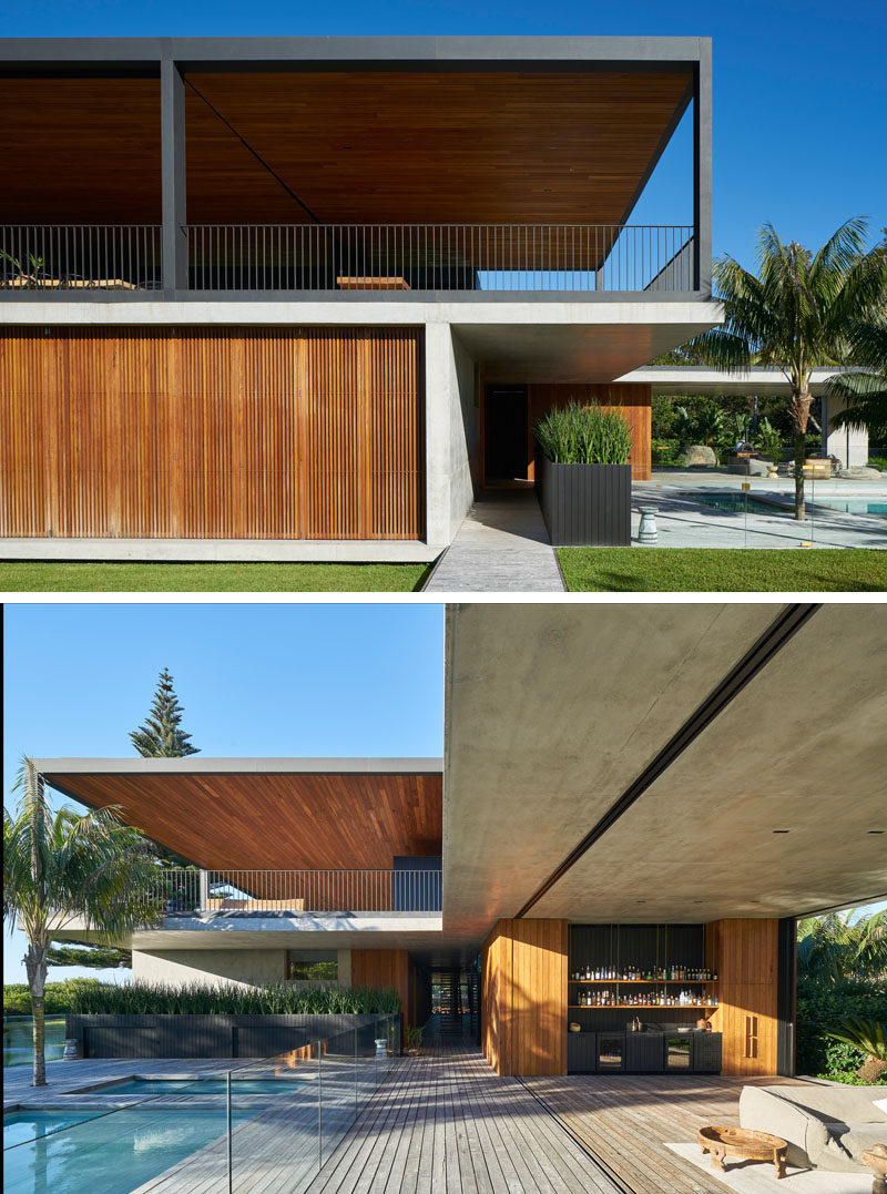 This Australian house has multiple outdoor areas, a swimming pool, and uses wood, steel and concrete to create a modern appearance. #Architecture #ModernHouse