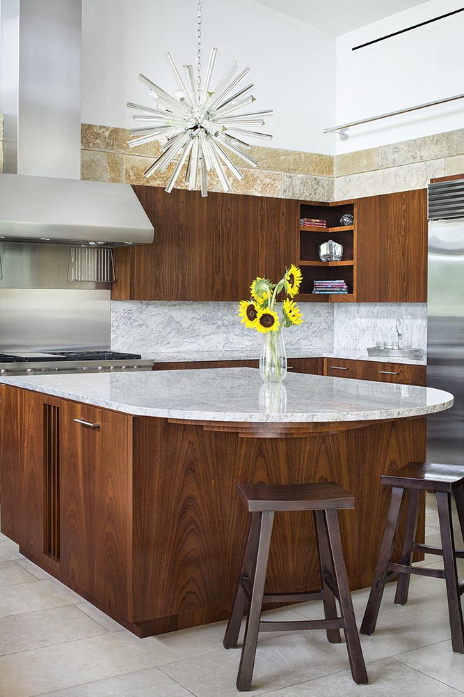 In this contemporary kitchen,custom designed wood kitchen cabinetry is topped with a marble countertop. #KitchenDesign #WoodKitchen #InteriorDesign