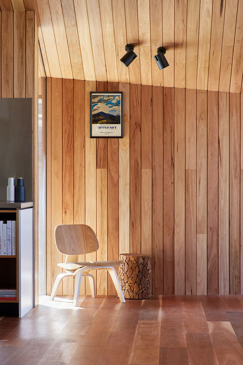 Silvertop ash lining boards have been used to cover the ceiling and walls throughout the interior of this modern house addition. #WoodWalls #WoodCeiling #WoodFloors #WoodInterior