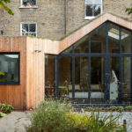A Modern Wood Rear Extension Was Added To This Home In England