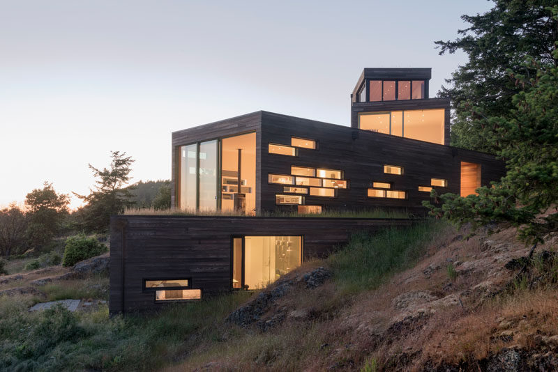 Architecture firm Prentiss + Balance + Wickline, have designed a multi-level, modern wood house in Friday Harbor, Washington State, that's anchored into the rocky slope. #ModernHouse #ModernArchitecture