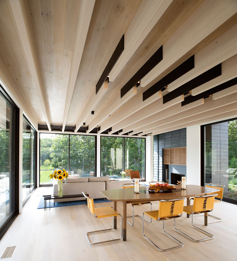 To achieve large open spans in this modern house, the wood beams are joined by steel flitch plates that also create a void for light fixtures. #Beams #LivingRoom #Architecture