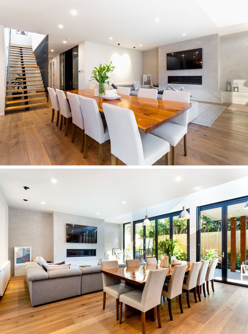 This dining area has a large wood table that separates the living room and the kitchen. #DiningRoom #InteriorDesign
