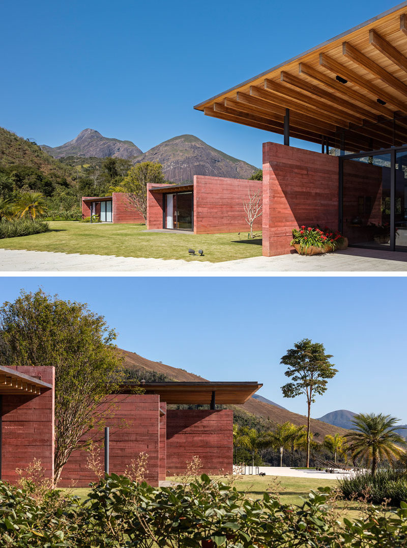 This modern house features pigmented concrete, protruding 'boxes', and an expansive wood roof that sits above the the main form of the house. #Architecture #PigmentedConcrete #ColoredConcrete #WoodRoof