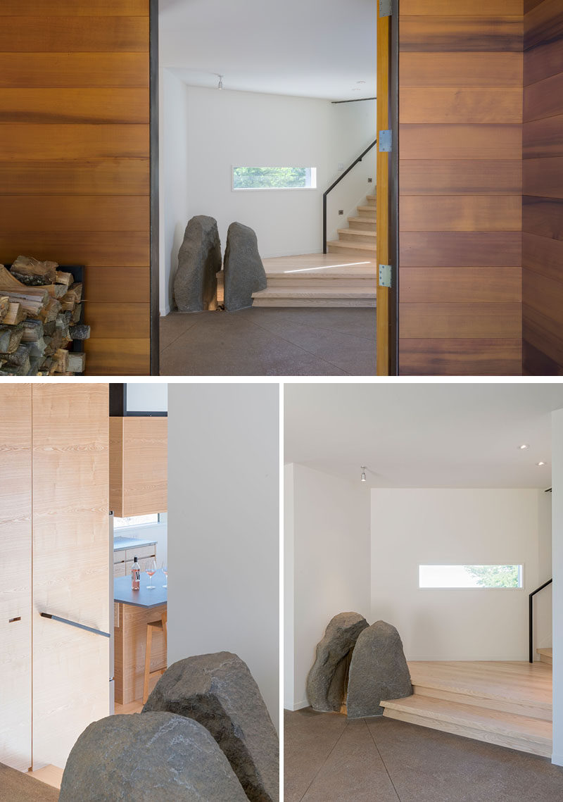 This modern house has a feature stone element, and wood stairs that connect the various boxes of the home. #StoneFeature #InteriorDesign