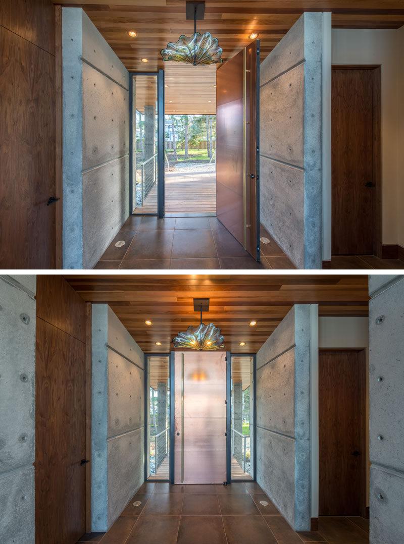 A tall metallic front door welcomes visitors to this beachfront studio. #FrontDoor #InteriorDesign