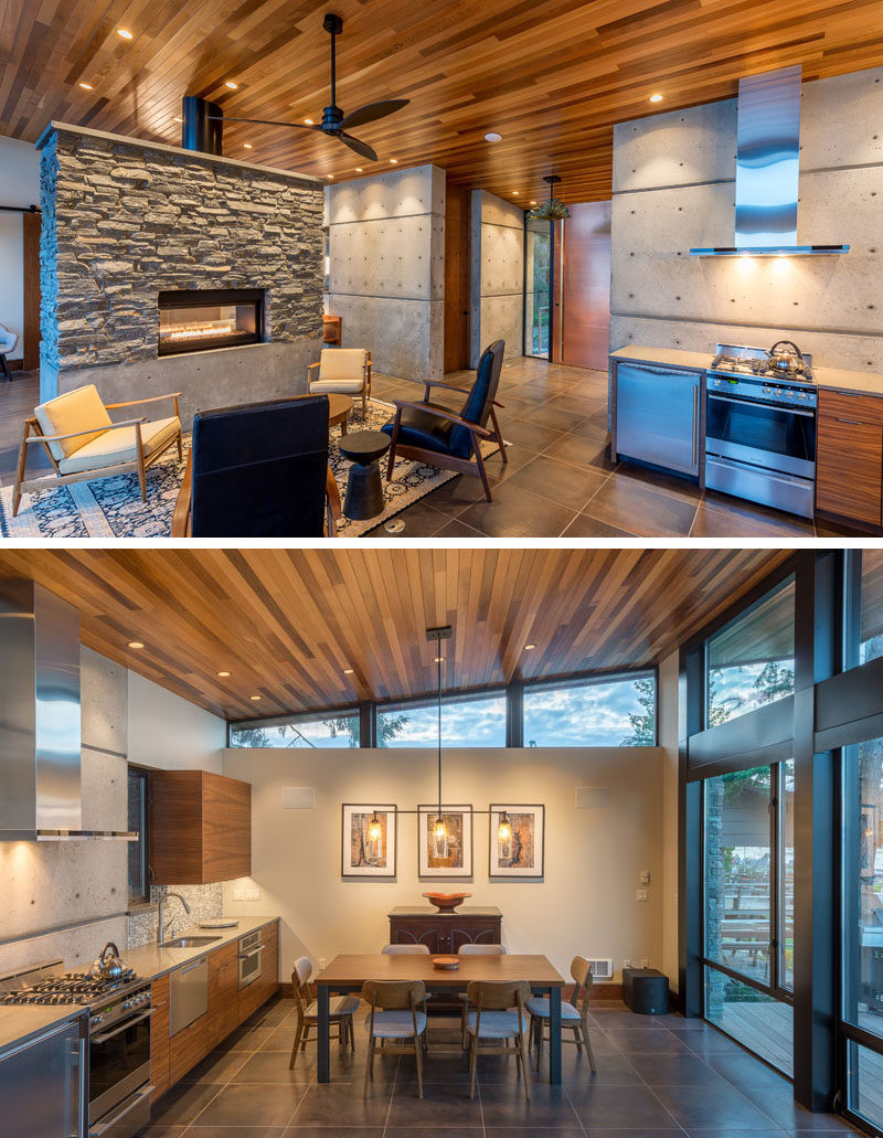 This modern beachfront cottage has been designed as a large open room, with the kitchen, dining, and living area separated from the bedroom by a free-standing double-sided stone and concrete fireplace. #StoneFireplace #InteriorDesign #SmallKitchen #DiningRoom