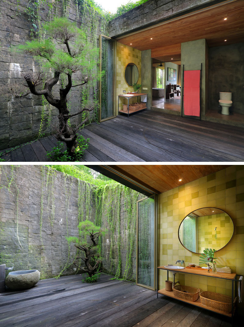 This bathroom opens up to a private courtyard with stone walls and a tree. #Bathroom #Courtyard #PrivateCourtyard