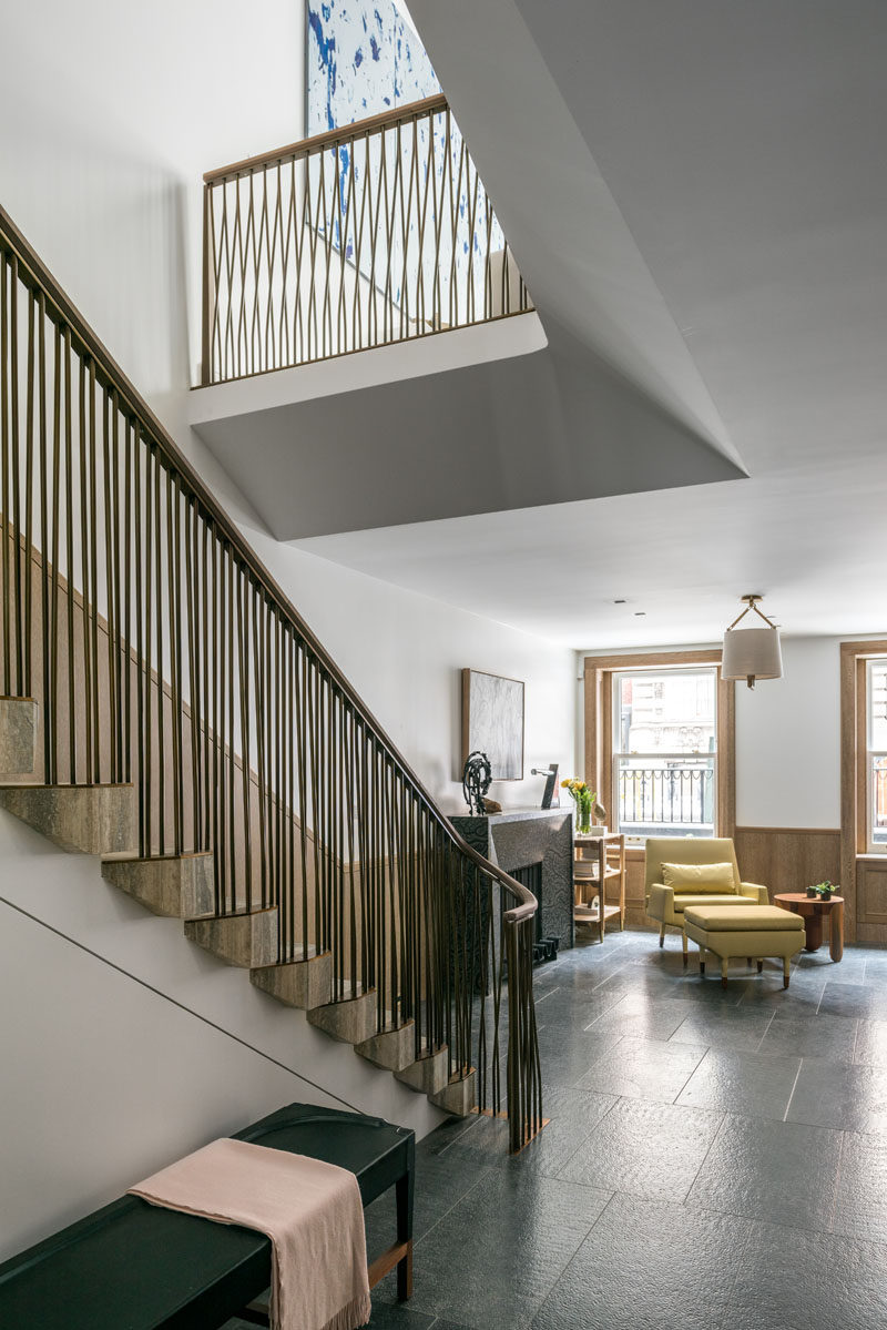 This contemporary row house has open areas that allow light through from the upper levels. #Stairs #InteriorDesign