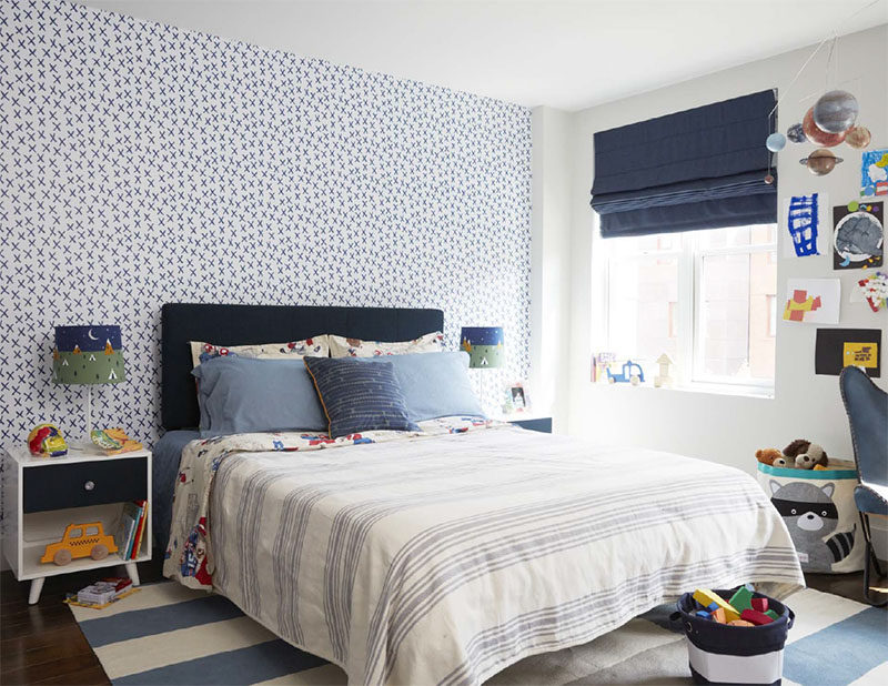 In kids modern kids bedroom, decorative wallpaper adds a graphic touch, while blue design elements have also been included. #Bedroom #KidsBedroom