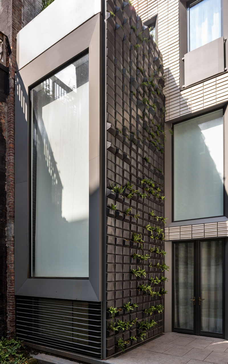 This row house has a custom 35 foot tall vertical garden built into the facade. #GreenWall #VerticalGarden