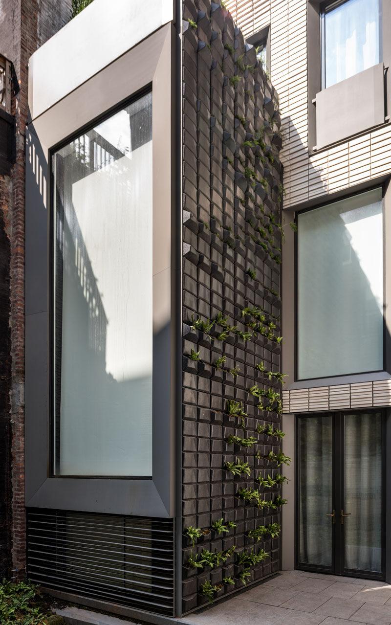 This row house has a custom 35 foot tall vertical garden built into the facade. #GreenWall #VerticalGarden