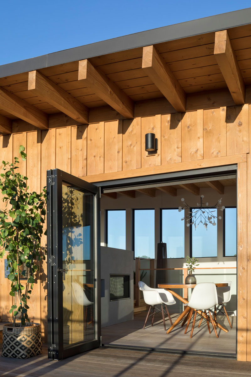 Bi-folding doors face onto the view deck from the dining area in order to maximize the connection to the outdoors. #Deck #Architecture #Doors