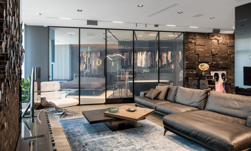 this modern and masculine apartment has a smart glass wall that can