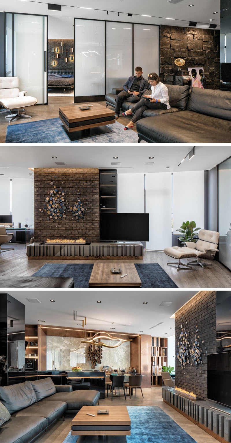 The dark interior palette of this modern apartment uses a variety of materials throughout its design, such as brick, natural African black stone, onyx, leather, copper ,wood etc. It also has a 'smart glass' wall that can change from opaque to transparent. #GlassWall #InteriorDesign #ApartmentDesign #ModernApartment