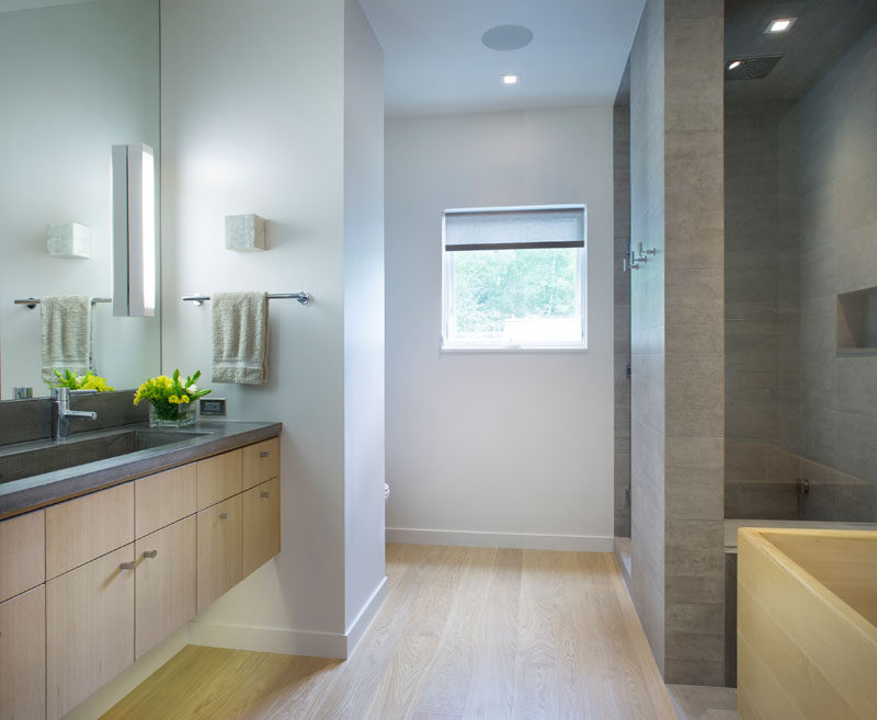 In this contemporary bathroom, the materials have been kept simple, and a hidden lights have been under the floating vanity. #BathroomDesign