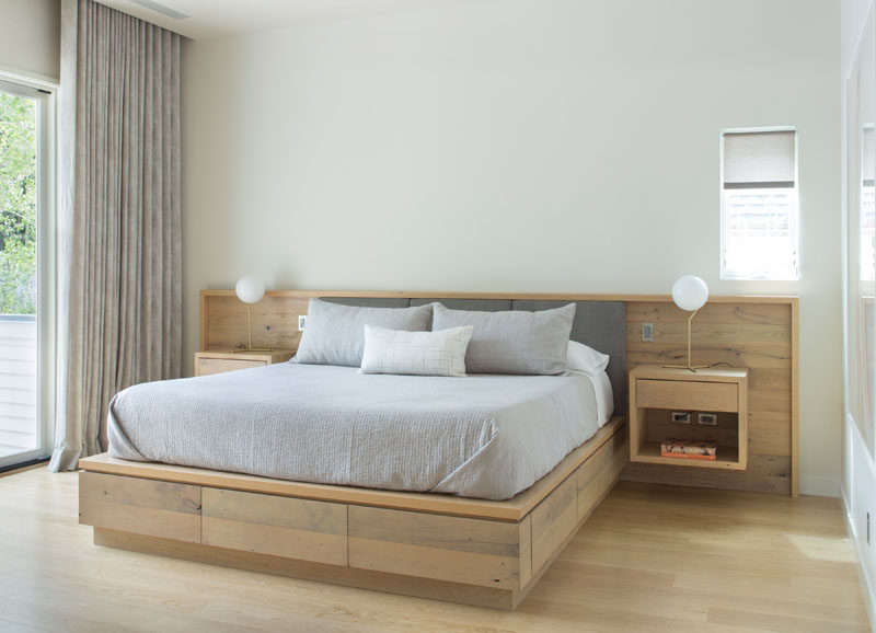 This contemporary bedroom features a custom designed built-in wood bed frame with floating bedside tables. #Bedroom #Bedframe #WoodBedframe #BedroomDesign