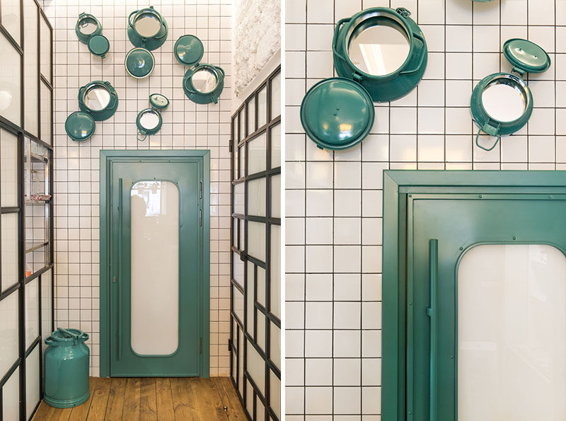 This modern cafe uses painted portholes with mirrors inside them as a decorative element. #CafeDesign #DesignAccent #WallDecor