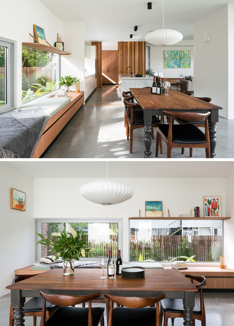 In this contemporary dining area, a long wood bench positioned beside the window creates a place to relax in the sunshine. #WindowBench #DiningRoom