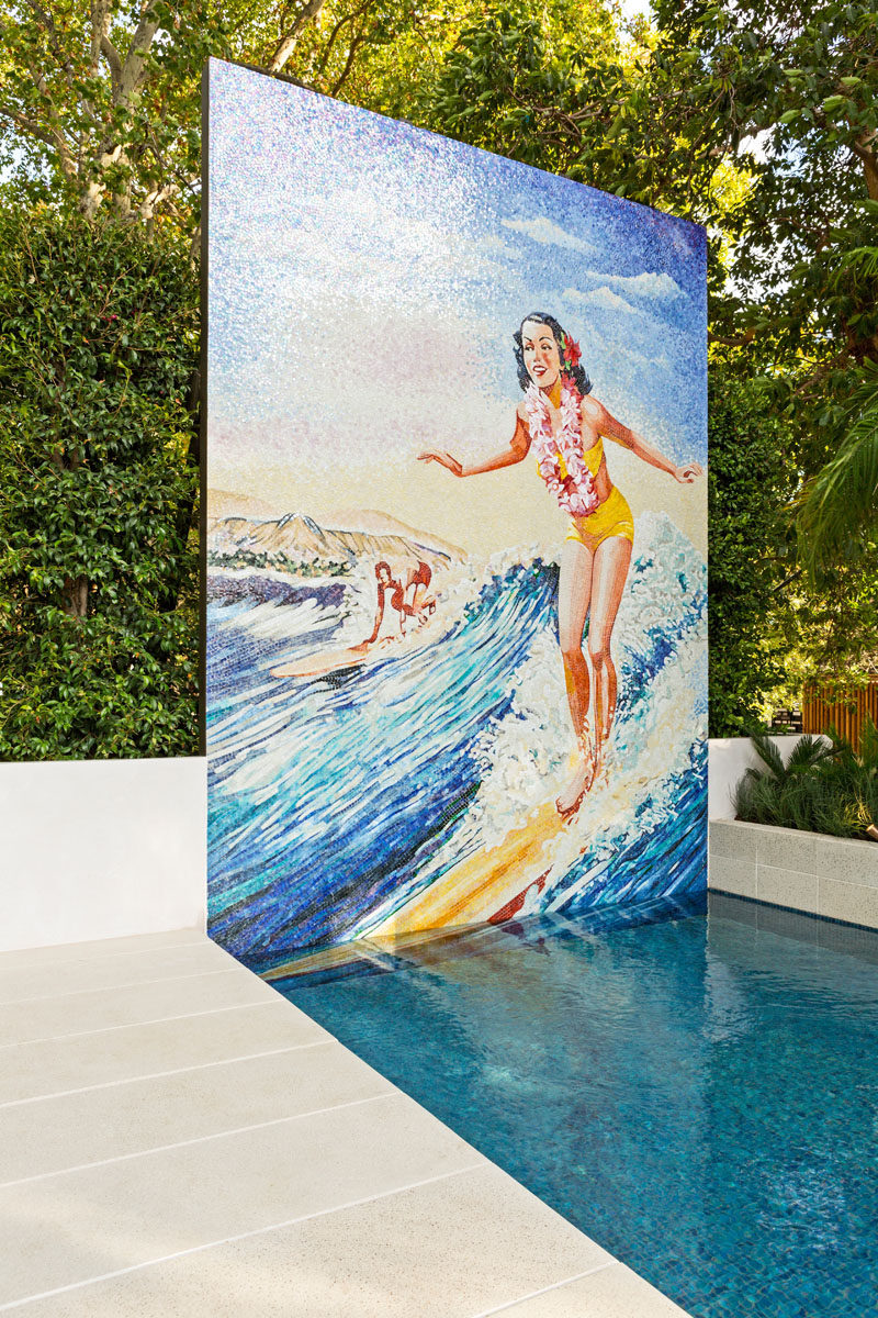 This modern pool features a hand-cut glass mosaic version of a classic Hawaiian surfer girls from the 1960s. #Mural #GlassMosaic #SwimmingPool