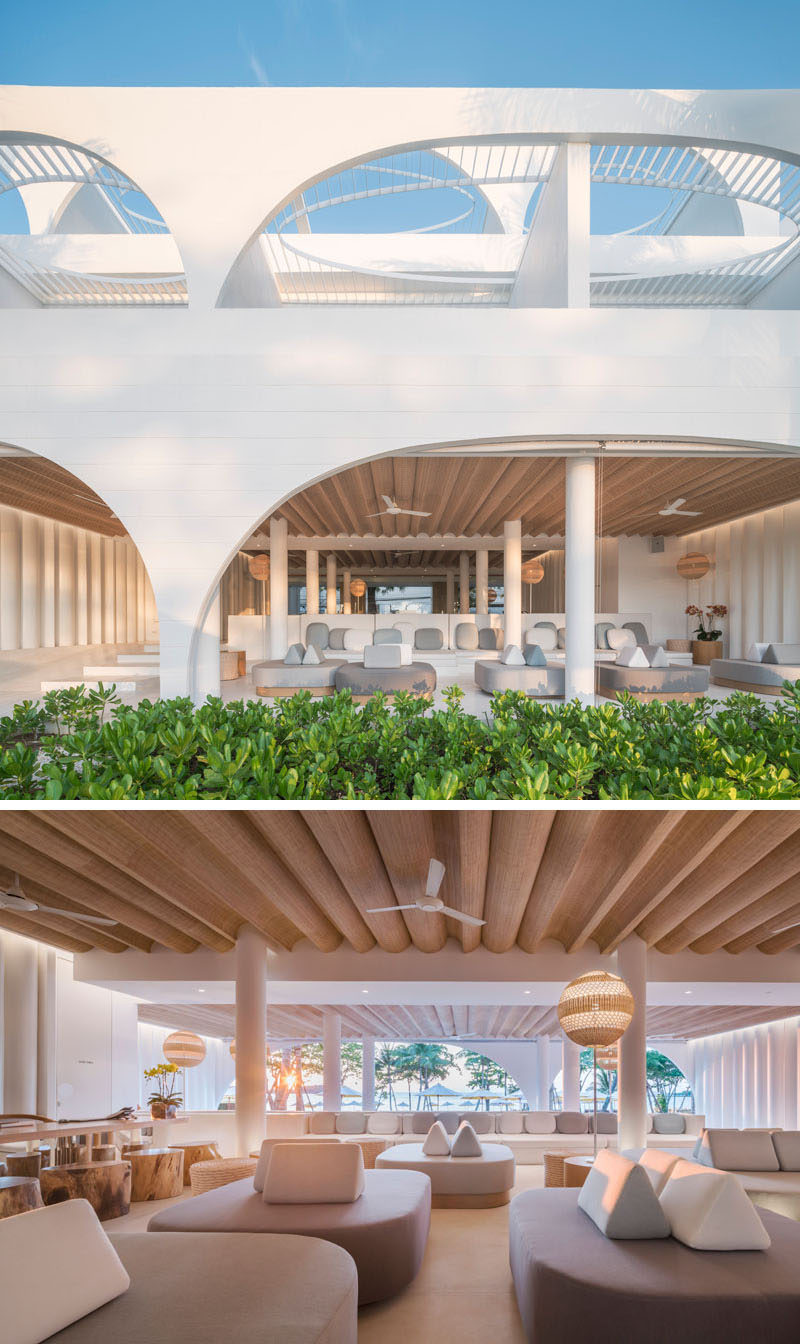 This modern hotel lobby has a lounge area that provides a place for guests to relax in the shade, while curved woven details form a unique ceiling accent. #HotelLobby #HotelDesign #HotelInterior