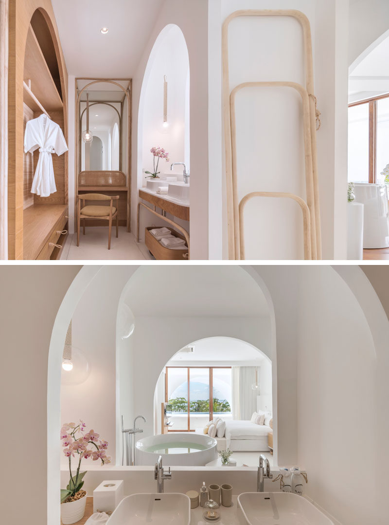 This hotel suite has arches that provide a view from the bathroom all the way through to the private swimming pool. #Bathroom #HotelRoom #Arches