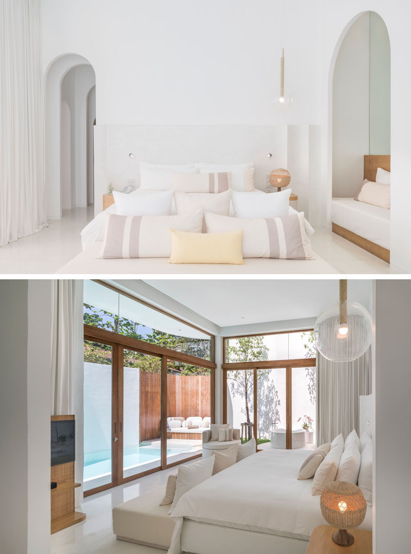 This modern hotel suite has wood accents that contrast the all white room. #HotelSuite #WhiteBedroom