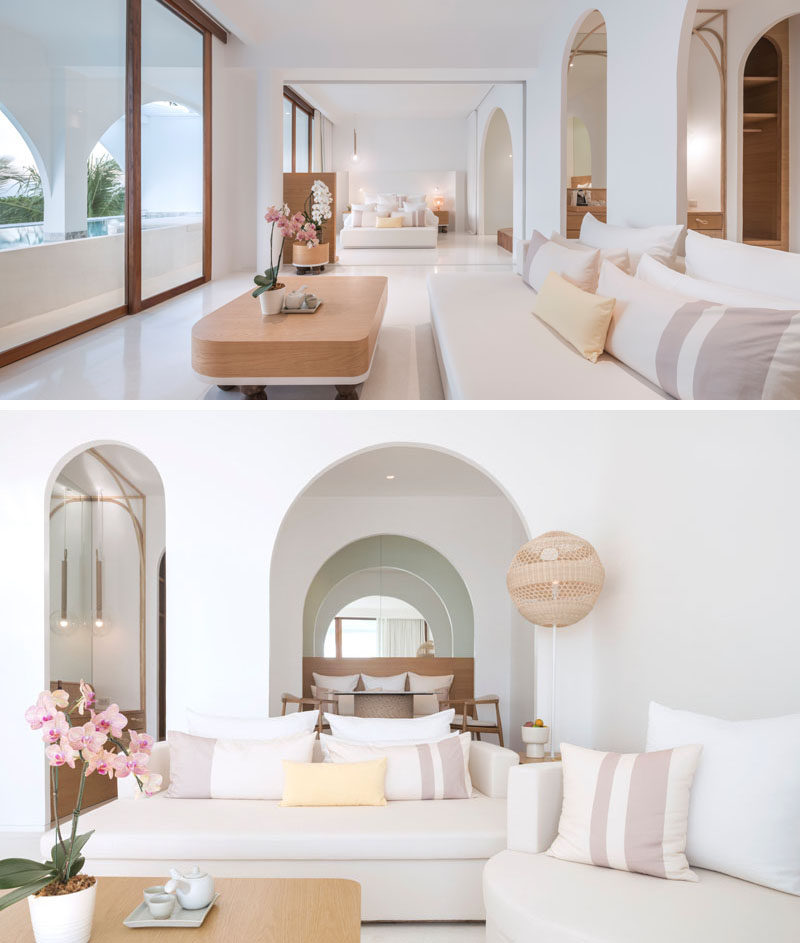 This modern hotel suite has a bright white interior with wood accents and arches, much like the rest of the hotel interior.#HotelSuite #HotelDesign #HotelRoom