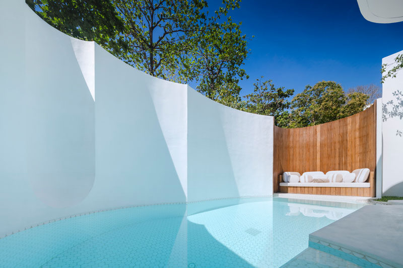 This modern hotel suite has its own private swimming pool and daybed for lounging by the pool. #SwimmingPool #HotelSuite