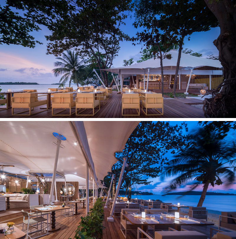This modern Thai resort has a wooden deck that provides a place to dine outdoors overlooking the ocean. #Restaurant #OutdoorDining #HotelDesign