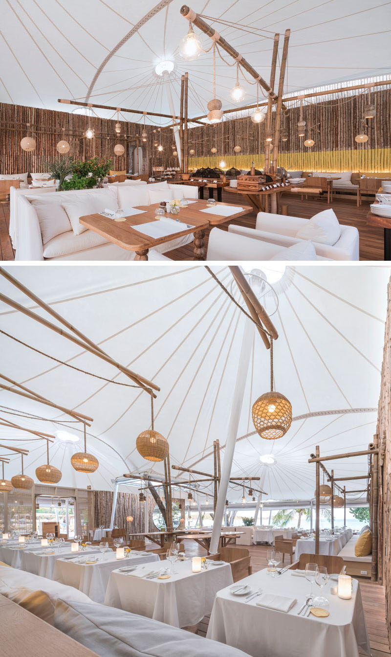 Inside this modern hotel restaurant, bamboo posts cover the walls, while the tent-like structure and woven maps create a relaxed dining environment. #Restaurant #ModernRestaurant #Resort