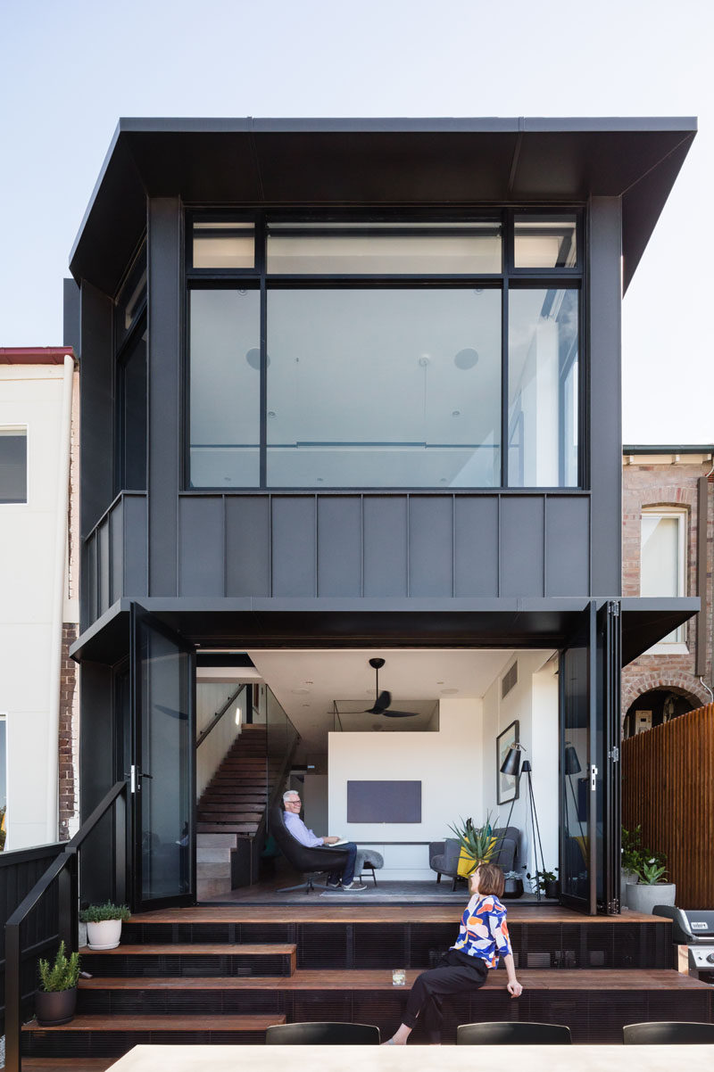 This modern house has bleacher-style steps extending the study and sitting room, forming an additional living space. #ExteriorStairs #ModernHouse