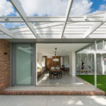 Kelder Architects Have Designed A House That Opens To A Courtyard With A BBQ Terrace, A Grassy Lawn, And A Pool