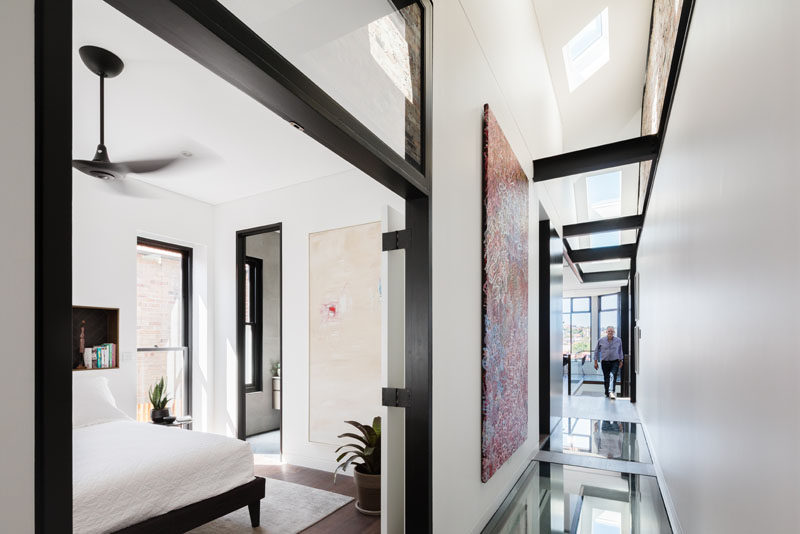 This modern house uses glass elements – skylights, glass flooring, highlight panels and balustrading – to create an open and bright interior. #GlassFloor #Skylights #ModernInterior