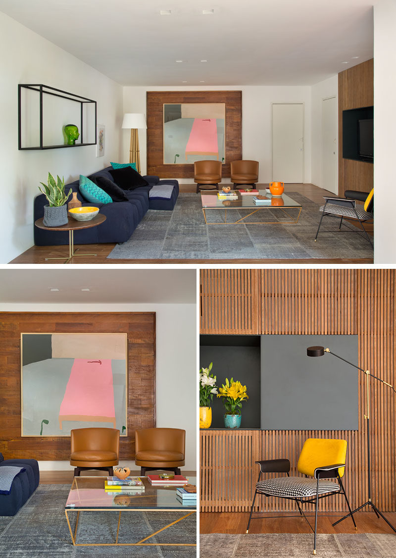 This modern living room features two different wood accent walls. #ModernLivingRoom #WoodAccentWall