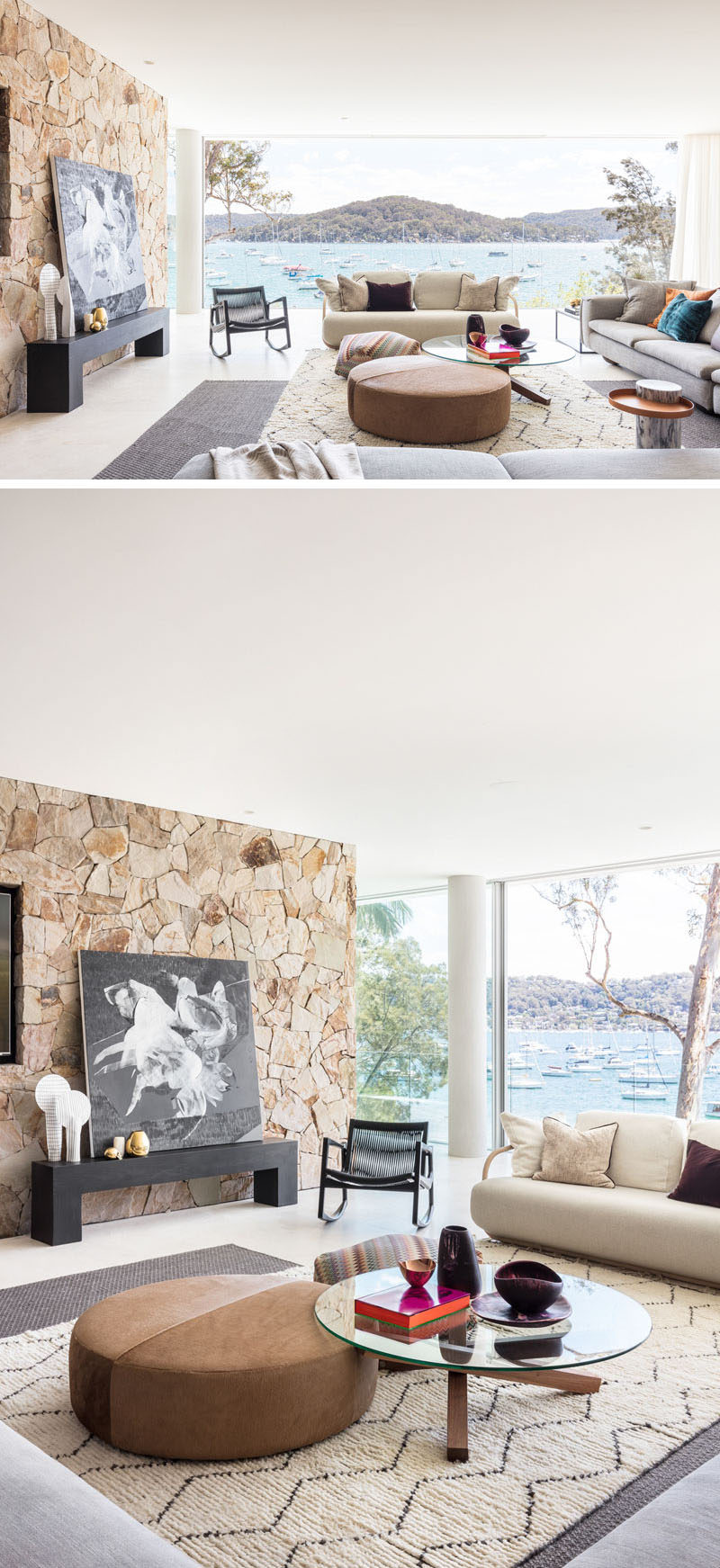 Throughout this modern waterfront house, sandstone-coloured stack stone has been used to create feature walls, while 'invisible' floor to ceiling Vitrocsa glass allows for uninterrupted views. #SandstoneWalls #Windows #LivingRoom