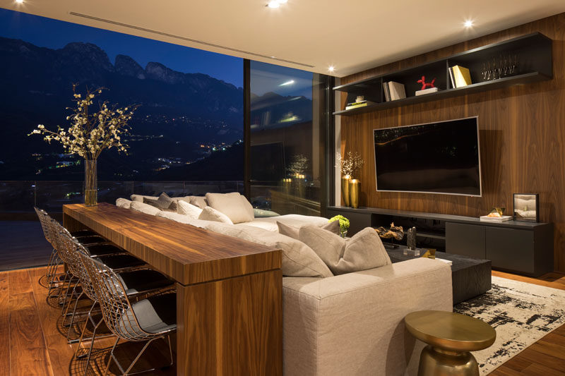 In this modern lounge area, a large sliding glass can open the space to the pool deck, however when closed off, the mountain views can still be admired. #LivingRoom #Lounge #InteriorDesign
