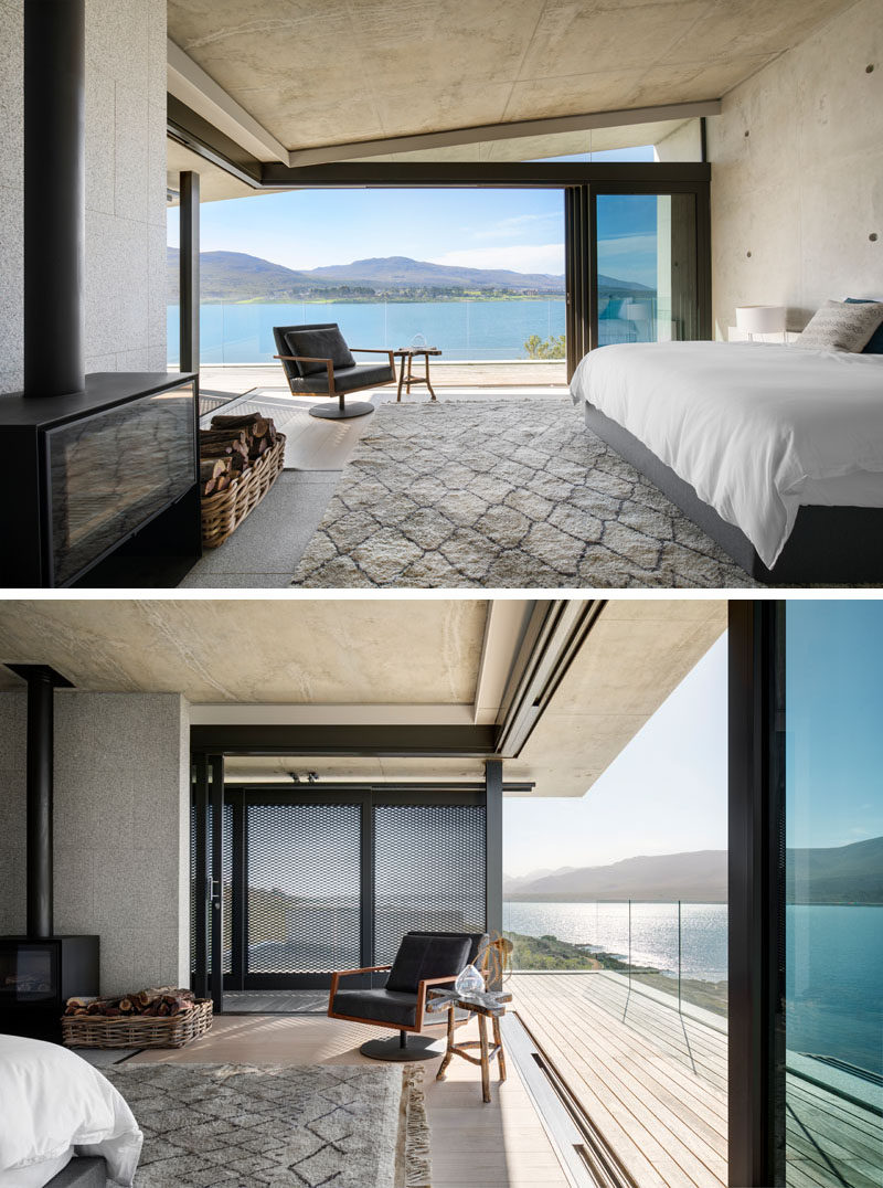 In this modern master bedroom suite, architectural materials such as concrete and granite have been used, while the bedroom is positioned to have elevated views across the lagoon and to the mountains beyond. #MasterBedroom #Fireplace #ModernBedroom