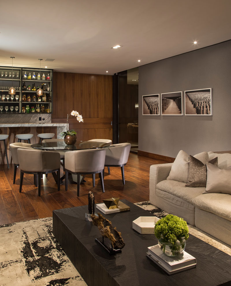 This modern house has a casual lounge and bar area with neutral tones and natural materials. #InteriorDesign #Bar #Dining #LivingRoom