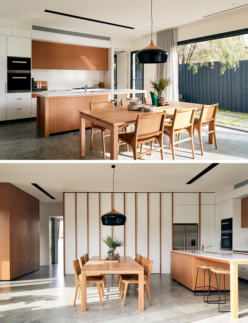 In this modern open-plan kitchen and dining room, light wood furniture and kitchen cabinets contrast the bright white walls. #ModernKitchen #ModernDiningRoom #OpenPlan #InteriorDesign