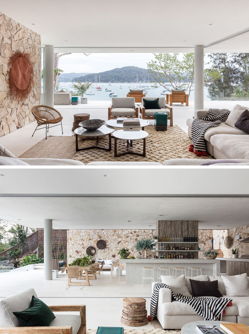 This modern waterfront house has a relaxed vibe, with a casual living room, dining area, and bar/kitchen. #LivingRoom #WaterfrontHouse #InteriorDesign