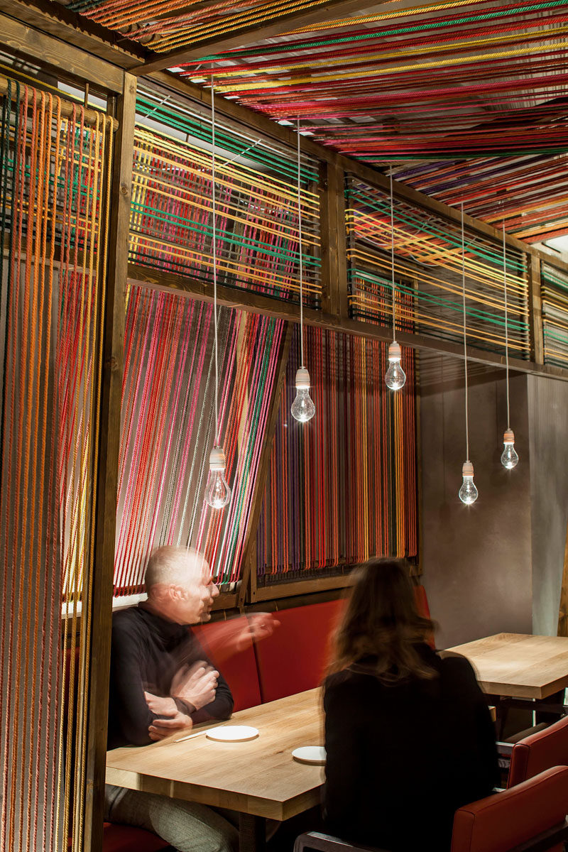 El Equipo Creativo have designed the Pakta Restaurant in Barcelona, Spain, that features an interior with brightly colored ropes. #InteriorDesign #RestaurantDesign #Rope #Ceiling