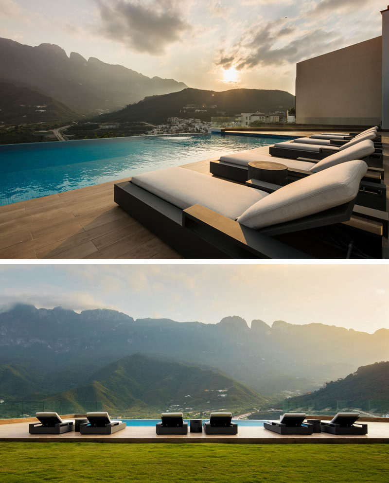 This modern swimming pool and deck have picturesque views of the mountains and surrounding area. #SwimmingPool #ModernPool #Sundeck