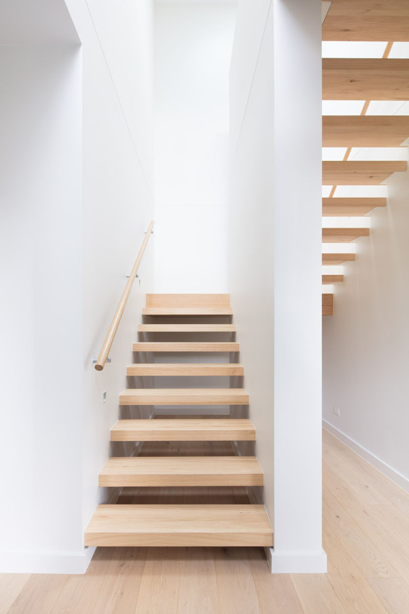 This open tread wood stairs are filled with natural light from a skylight. #Stairs #WoodStairs #OpenTreadStairs