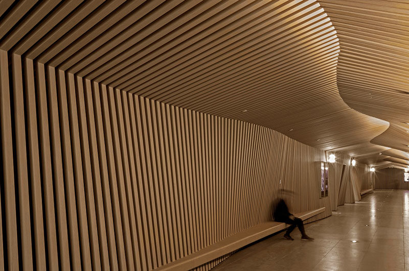 The designers of this modern cinema used wood slats to represent their inspirations, movie scripts and animation flip books. #WoodSlats #Cinema #InteriorDesign #MovieTheatre