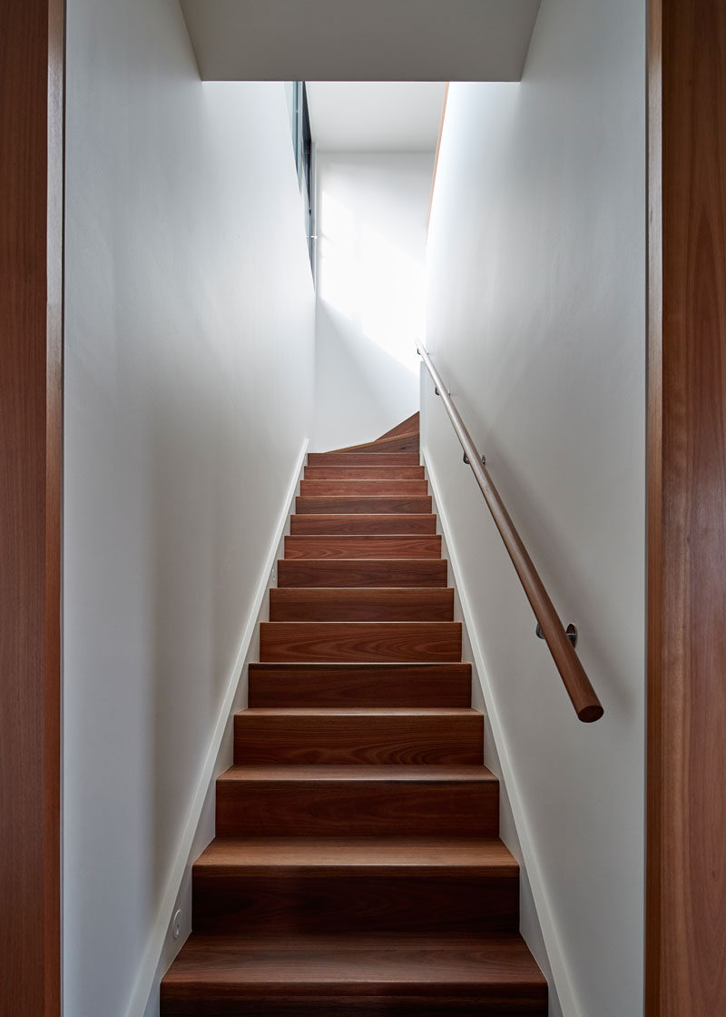 These simple and contemporary wood stairs are made from naturally oiled spotted gum. #WoodStairs #ContemporaryStairs #WoodAndWhite