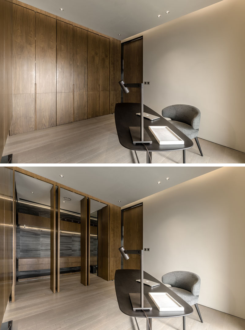 In this home office that shares the bedroom, a wall of wood paneling opens up to reveal a walk-in closet. #WalkInCloset #HomeOffice #Doors