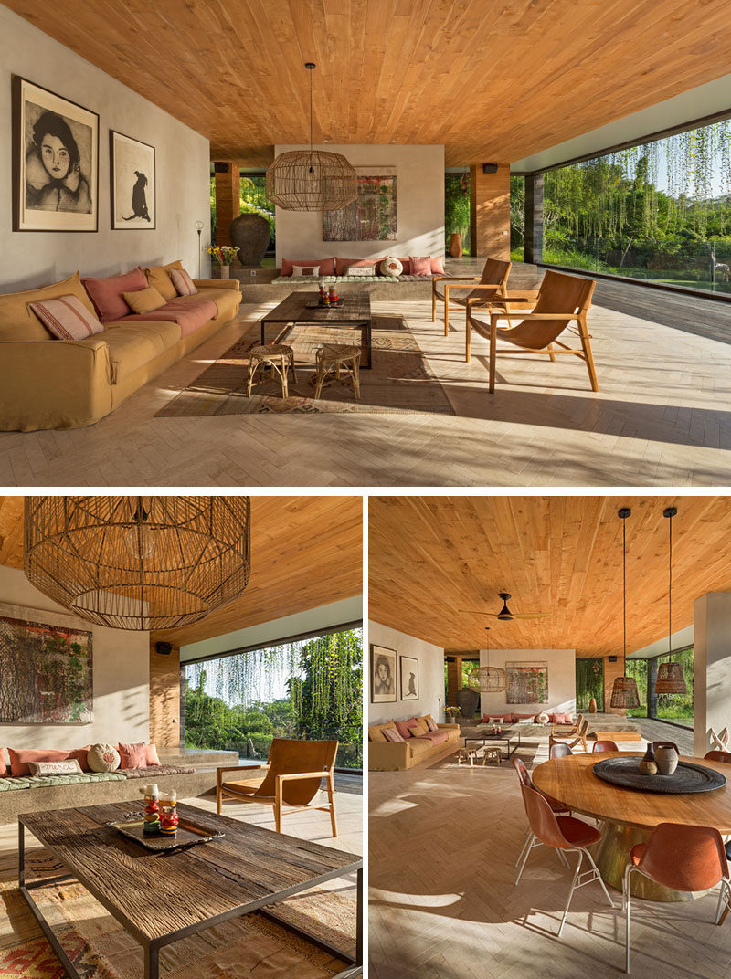 All of the social areas of this modern house, like the living room, have been kept open towards the elements, whereas the bedrooms and other more private spaces such as office, gym, and media room can be closed off. #ModernLivingRoom #WoodCeiling