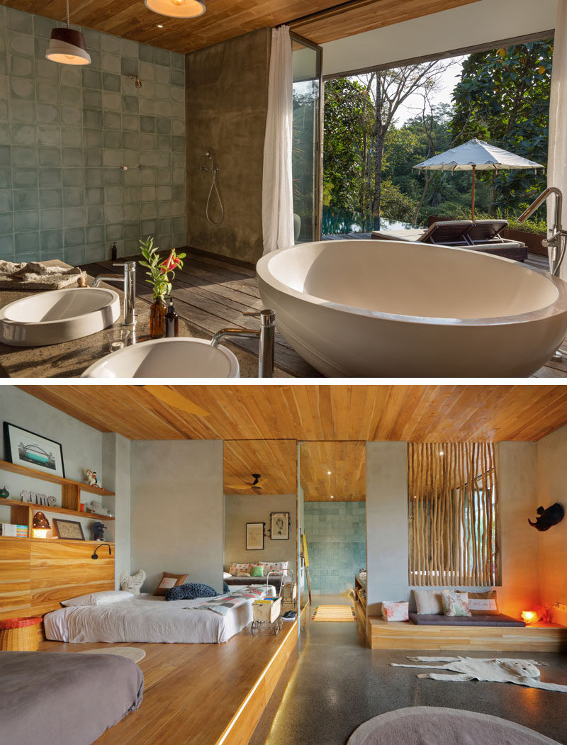 This modern bathroom that's open to the swimming pool deck, has a freestanding circular bathtub. The bathroom is also open to a bedroom, that has raised platforms for the beds to rest on. #CircularBathtub #ModernBathroom #Bedroom